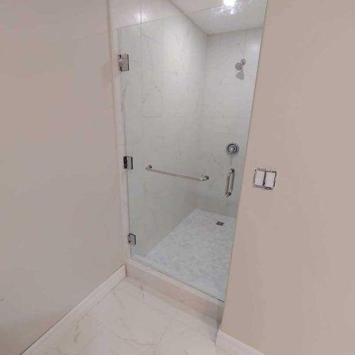 glass shower door with metal handle