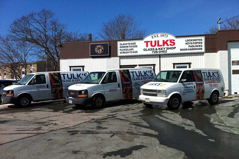 three Tulks Glass and Key Shop service vans infront of the store