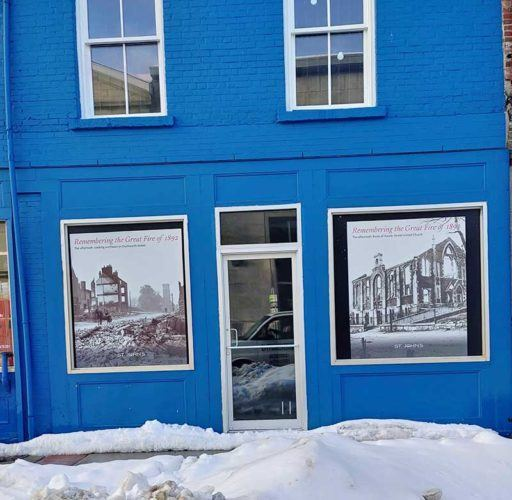 glass aluminum door of a blue building