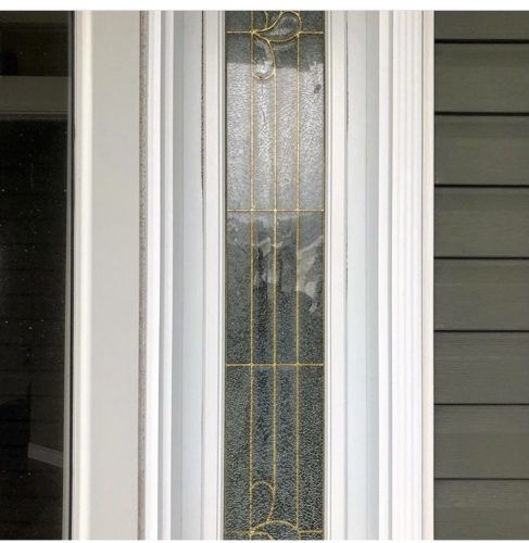 glass door with gold accent lines and white trim