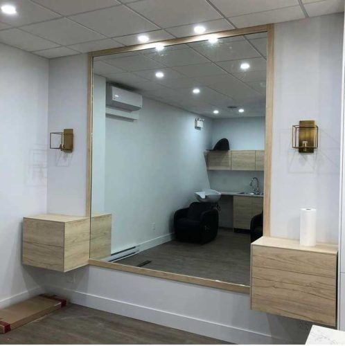 large mirror with wood trim inside a house entrance